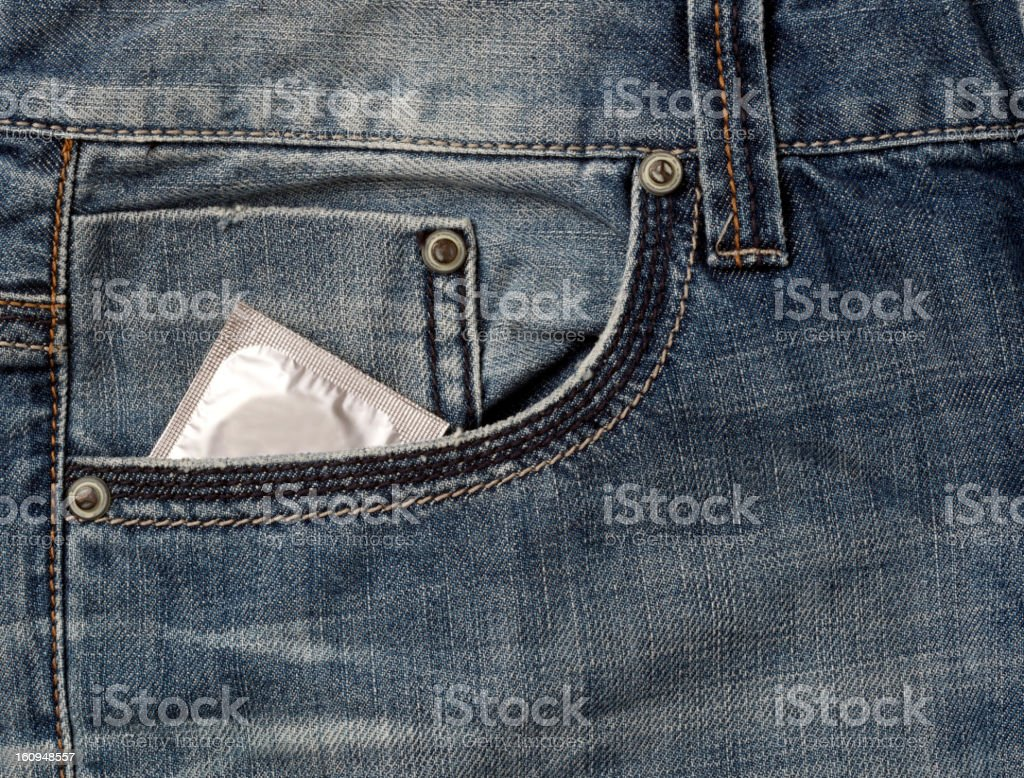 condom  in the jeans pocket stock photo