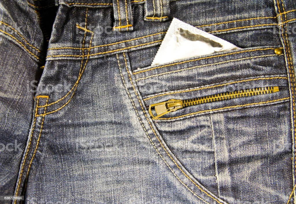 Condom in the pocket of  blue jeans stock photo