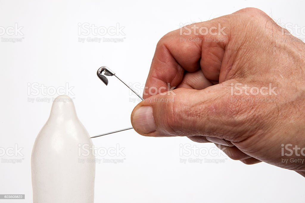 Condom prick stock photo