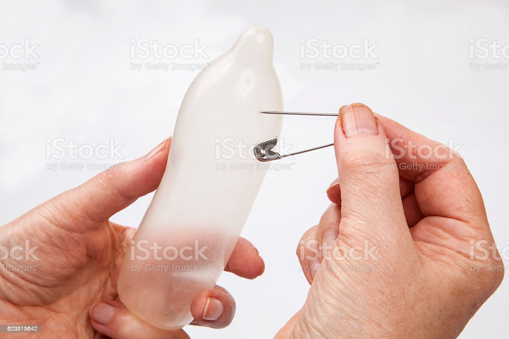 Condom prick stock photo