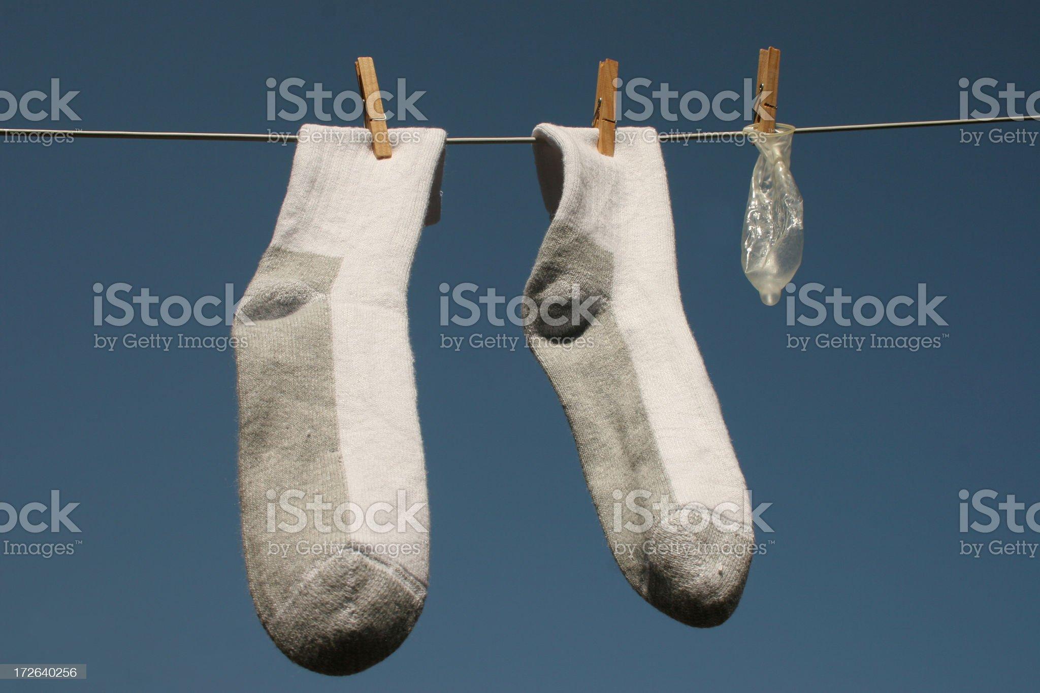 Condom with socks royalty-free stock photo