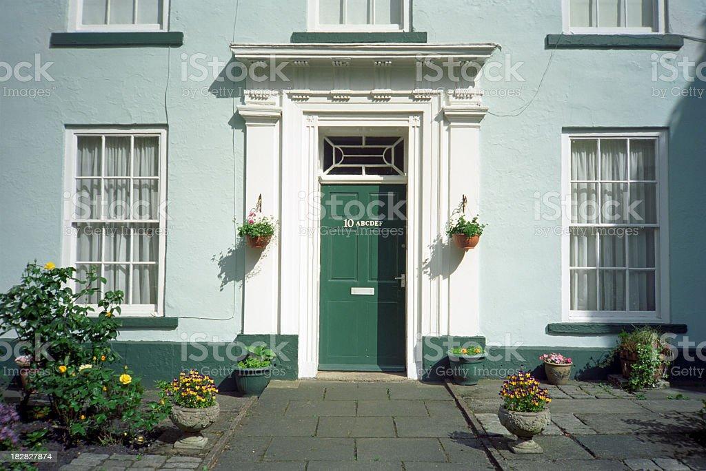 Condominio - English house entrance and facade with multiple address stock photo