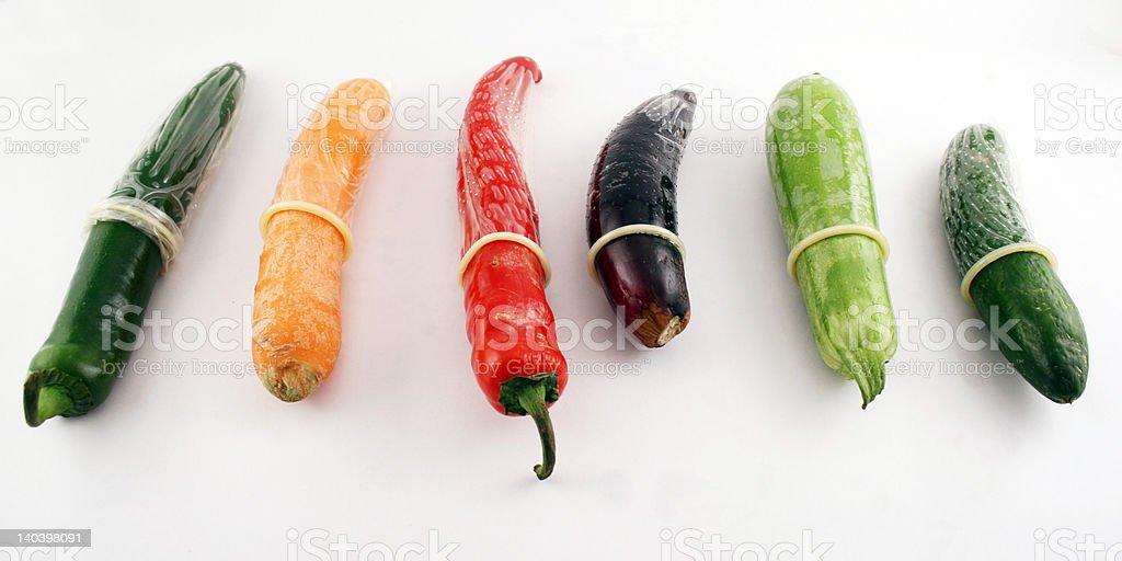 Condoms on vegetables stock photo