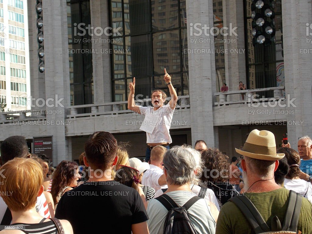 Conducting Crowd During Public Concert stock photo