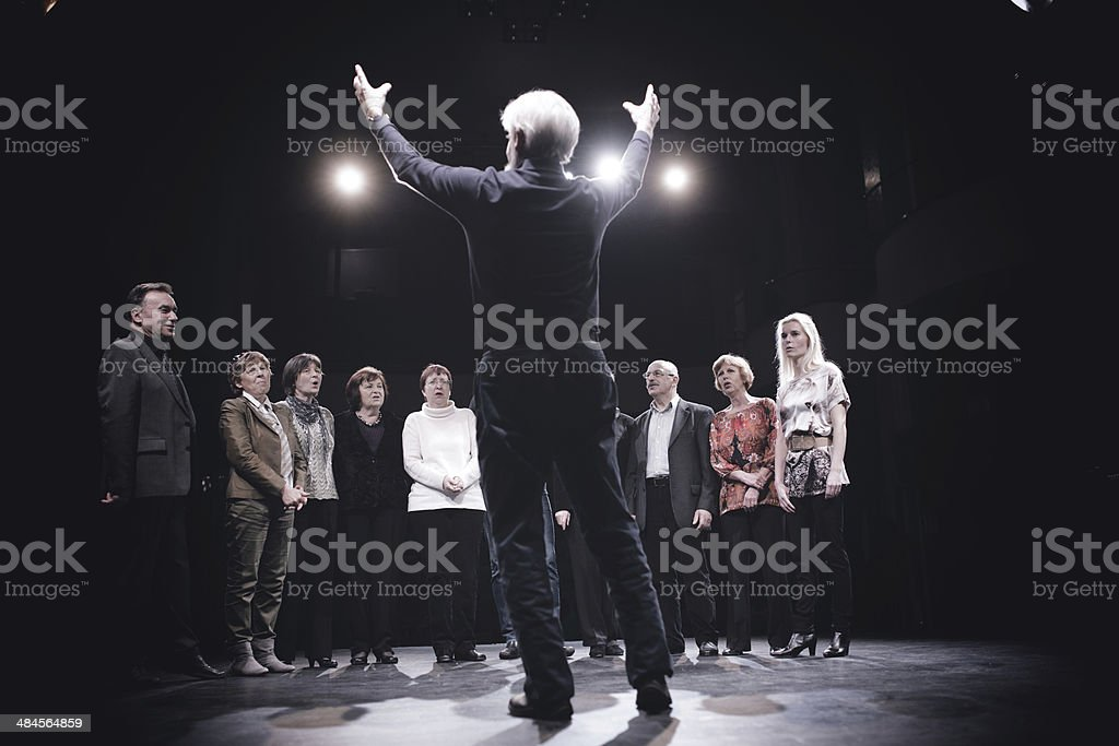 Conductor and Choir on stage stock photo