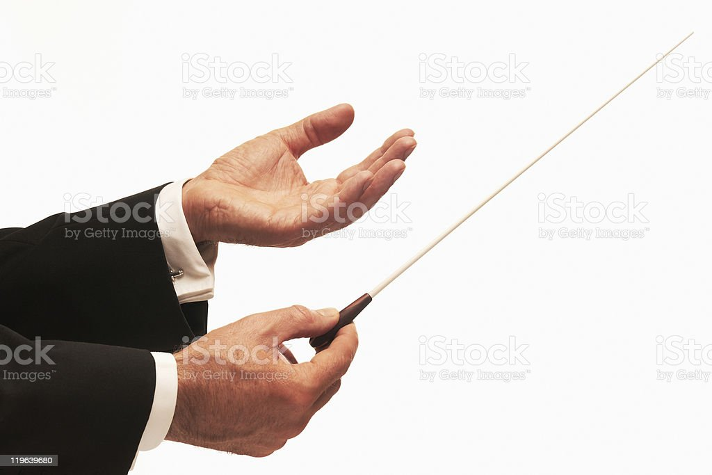 A conductor conducting an orchestra stock photo