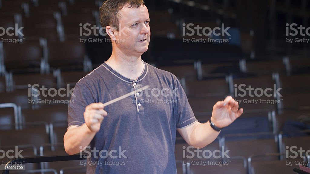 Conductor during orchestral rehearsal stock photo