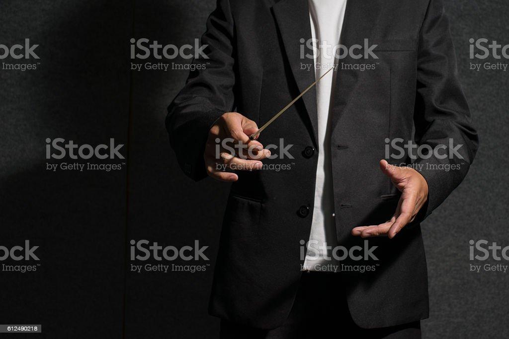 conductor in dark stock photo