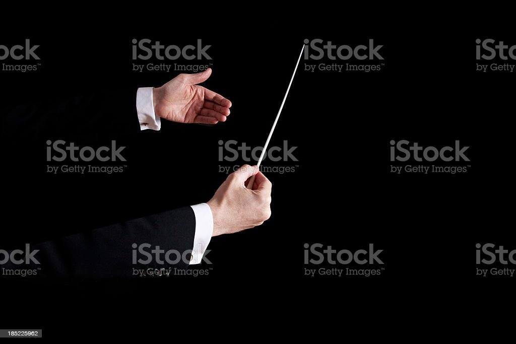 Conductor using his hands to orchestrate stock photo
