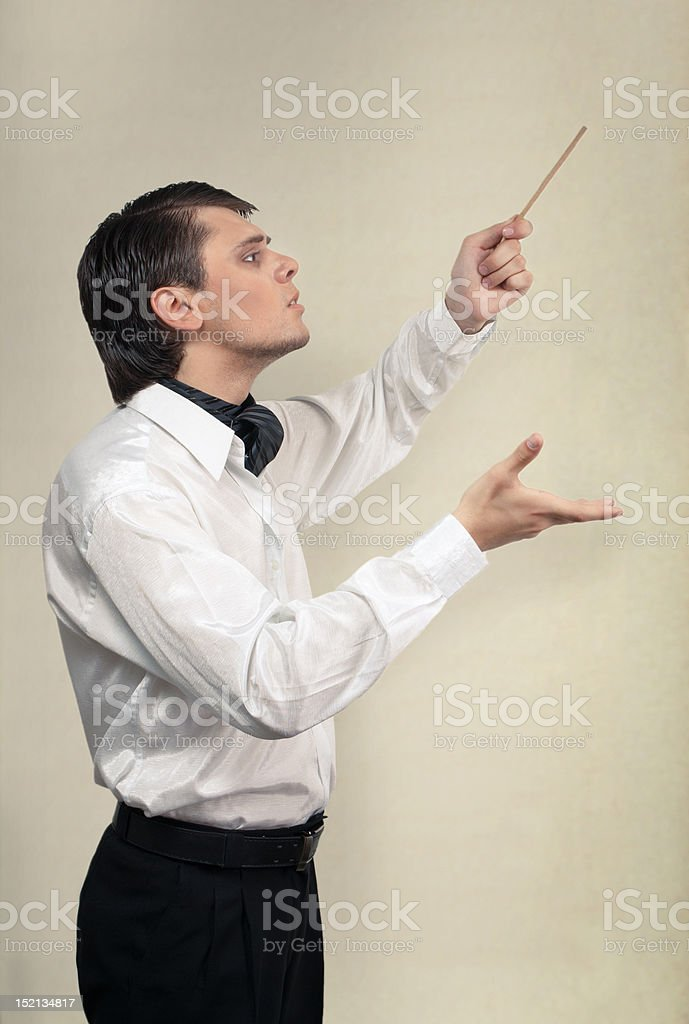 Conductor with baton in studio royalty-free stock photo
