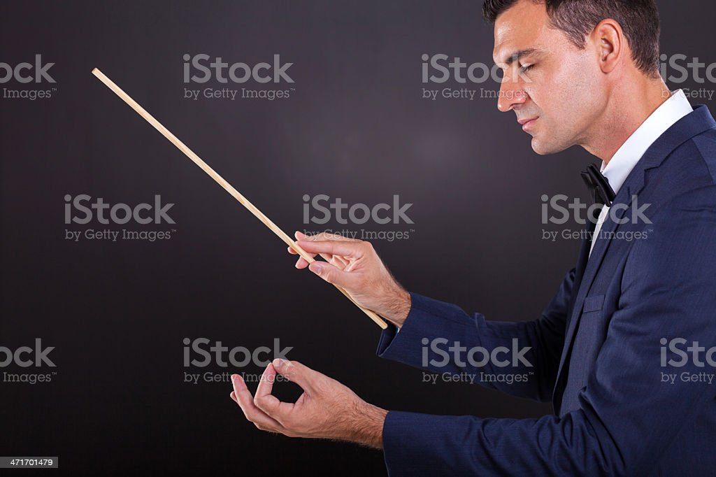 conductor with eyes closed stock photo
