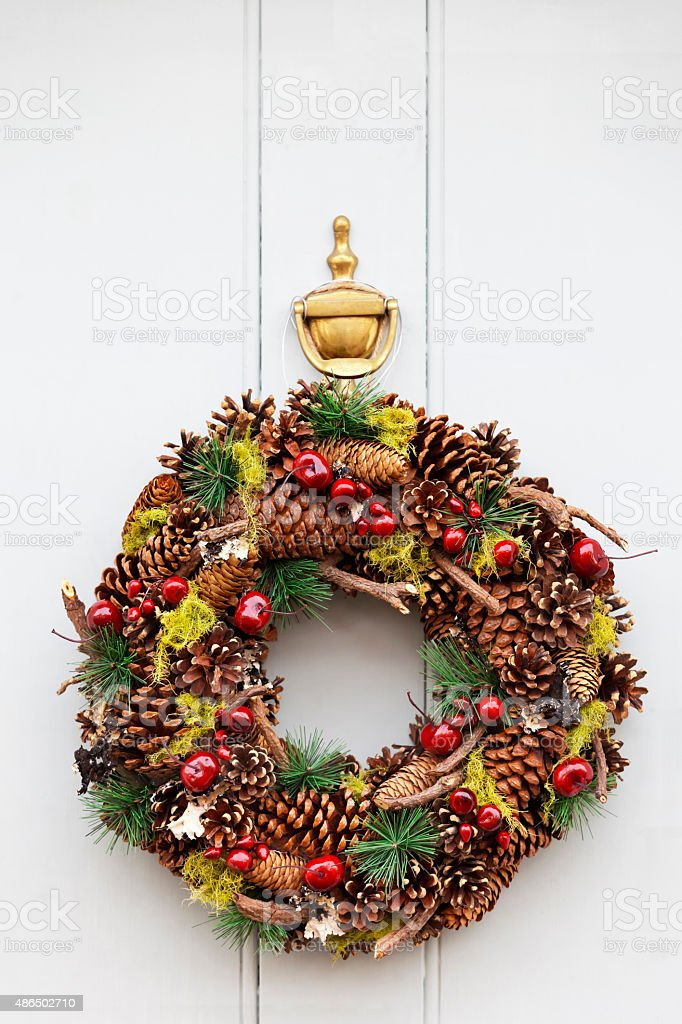 Cones and Berries Christmas Wreath stock photo