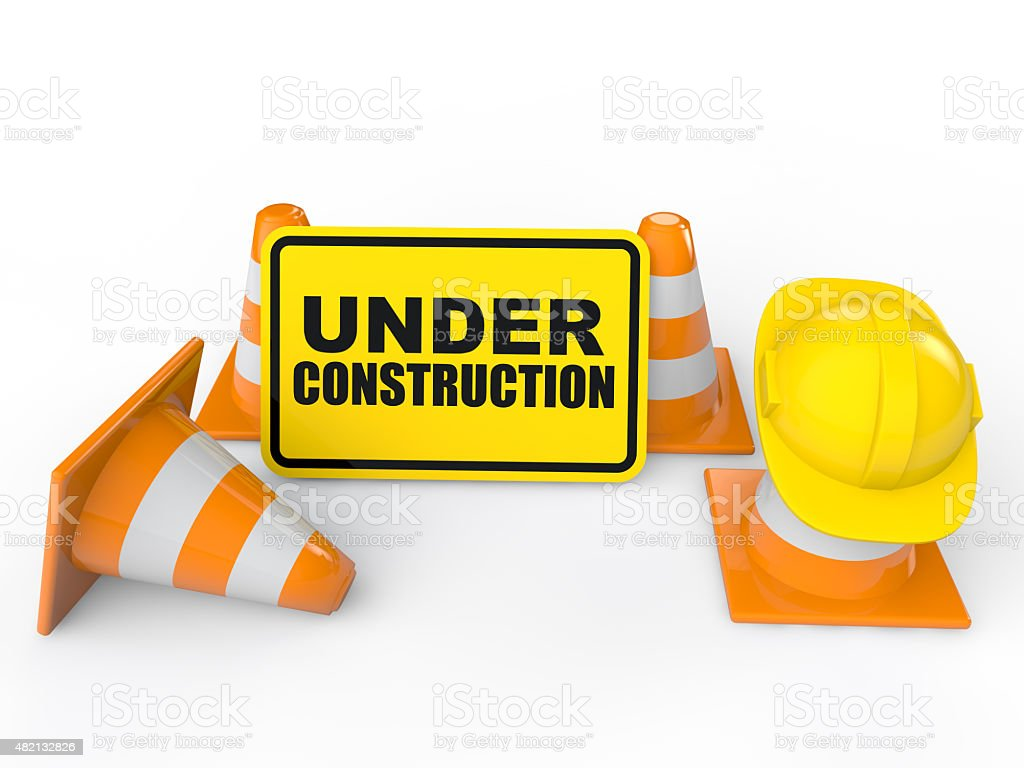 Cones and under construction sign stock photo