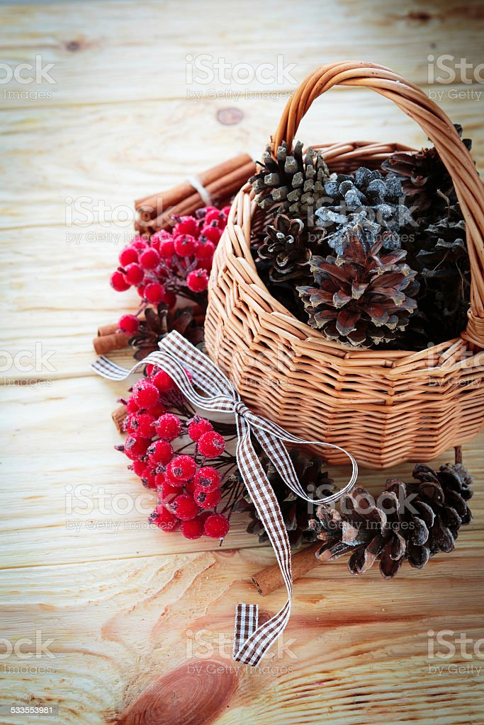cones in baskets and other christmas decorations stock photo