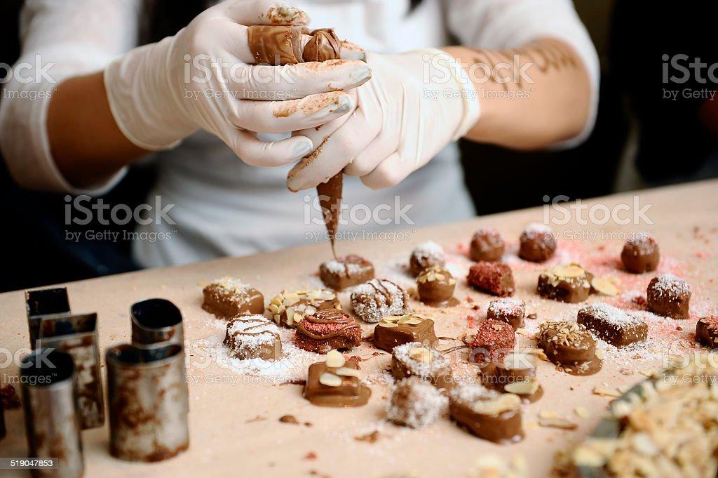 Confectioner decorated chocolates. stock photo