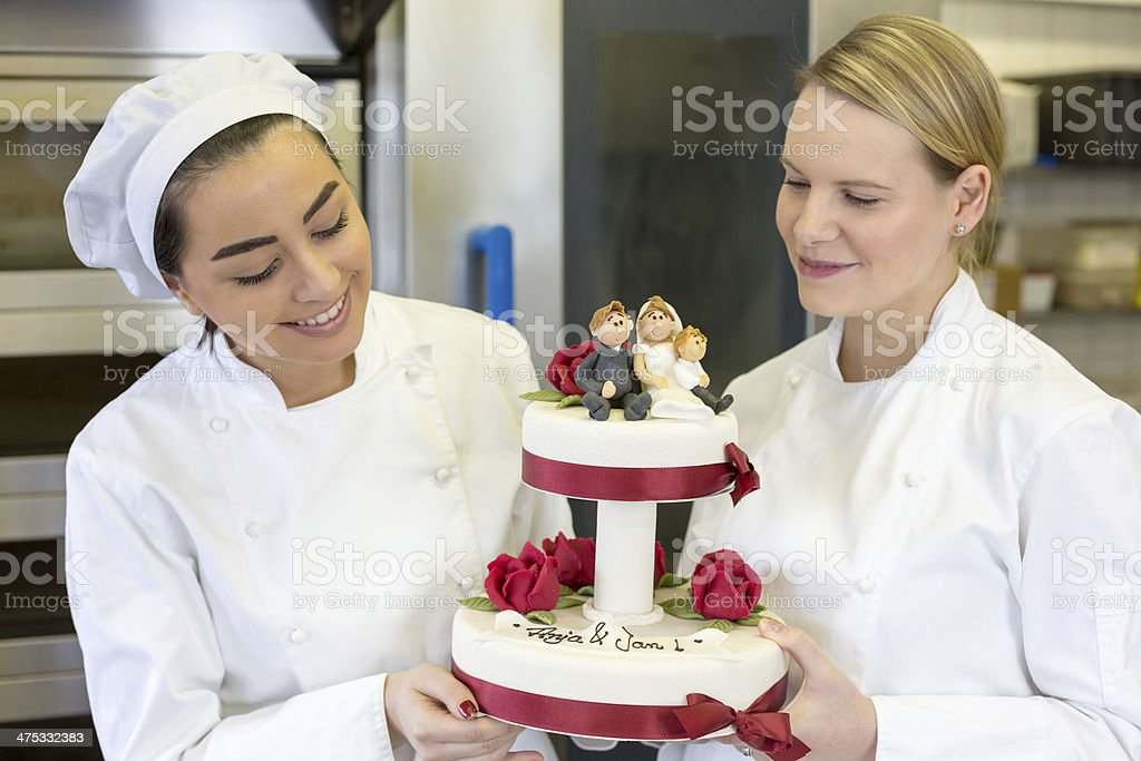 Confectioners or bakers presenting wedding cake stock photo