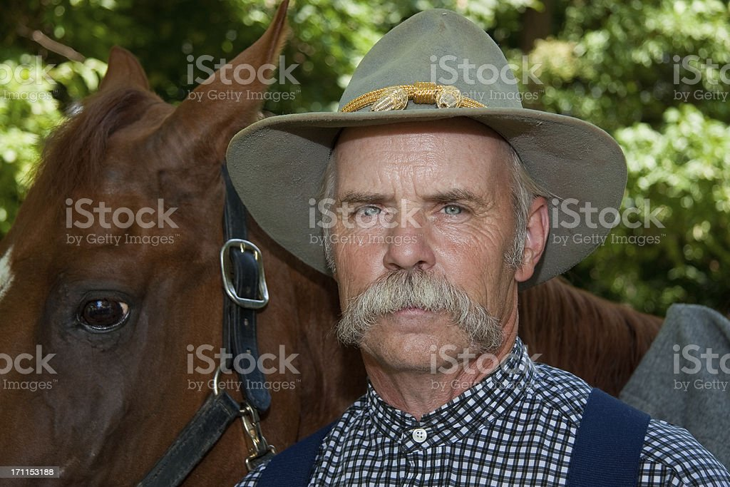 Confederate Cavalry Soldier With His Horse stock photo