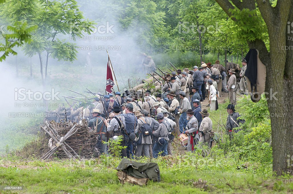 Confederate Civil War Renactors Fire at Union Troops stock photo