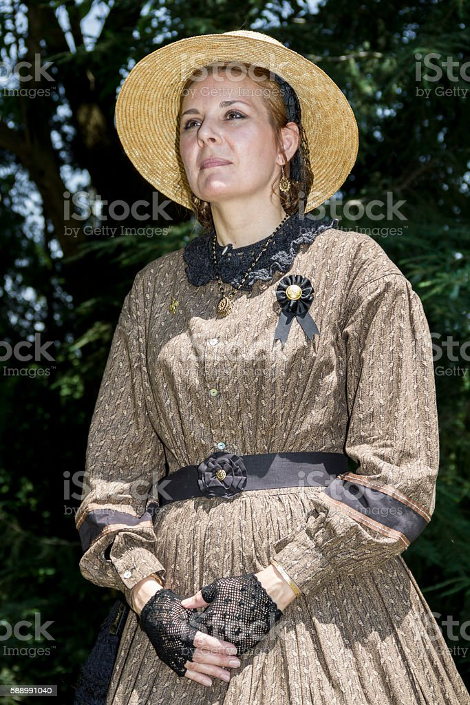Confederate Woman Wearing American Civil War Era Dress and Hat stock photo
