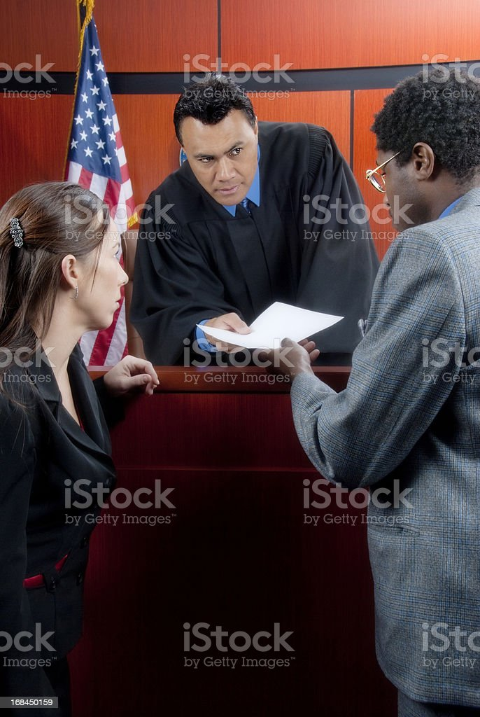 Conference between judge and attorneys in the courtroom stock photo