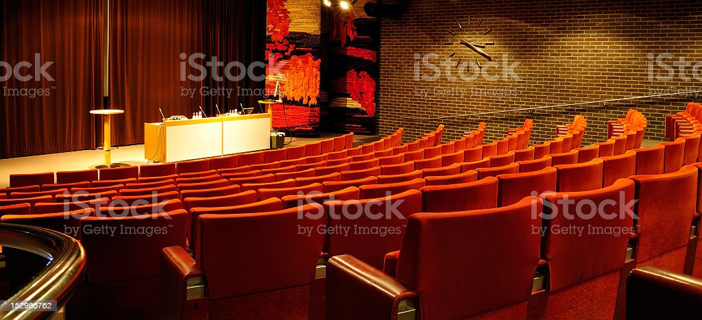 Conference center with red seats stock photo