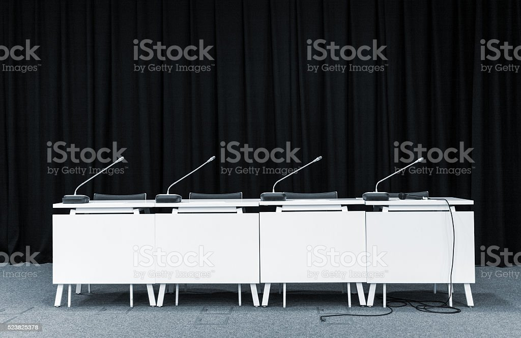 Conference microphones in a meeting room stock photo