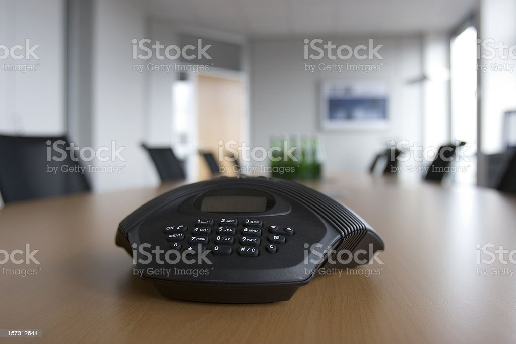 Conference phone in a meeting room stock photo