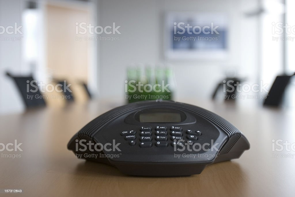 Conference phone in meeting room stock photo