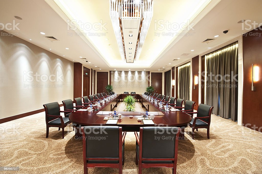 Conference room with a long table and lots of chairs stock photo