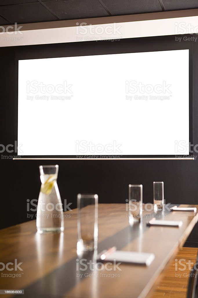 Conference room with a white screen stock photo