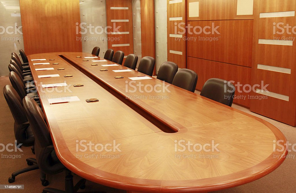 Conference room with large wooden table and leather chairs royalty-free stock photo