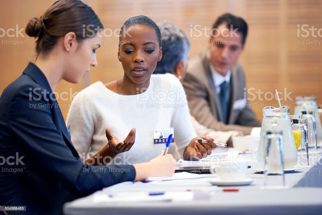 Conferring colleagues stock photo