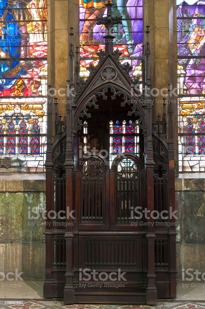 Confessional and stained-glass window royalty-free stock photo