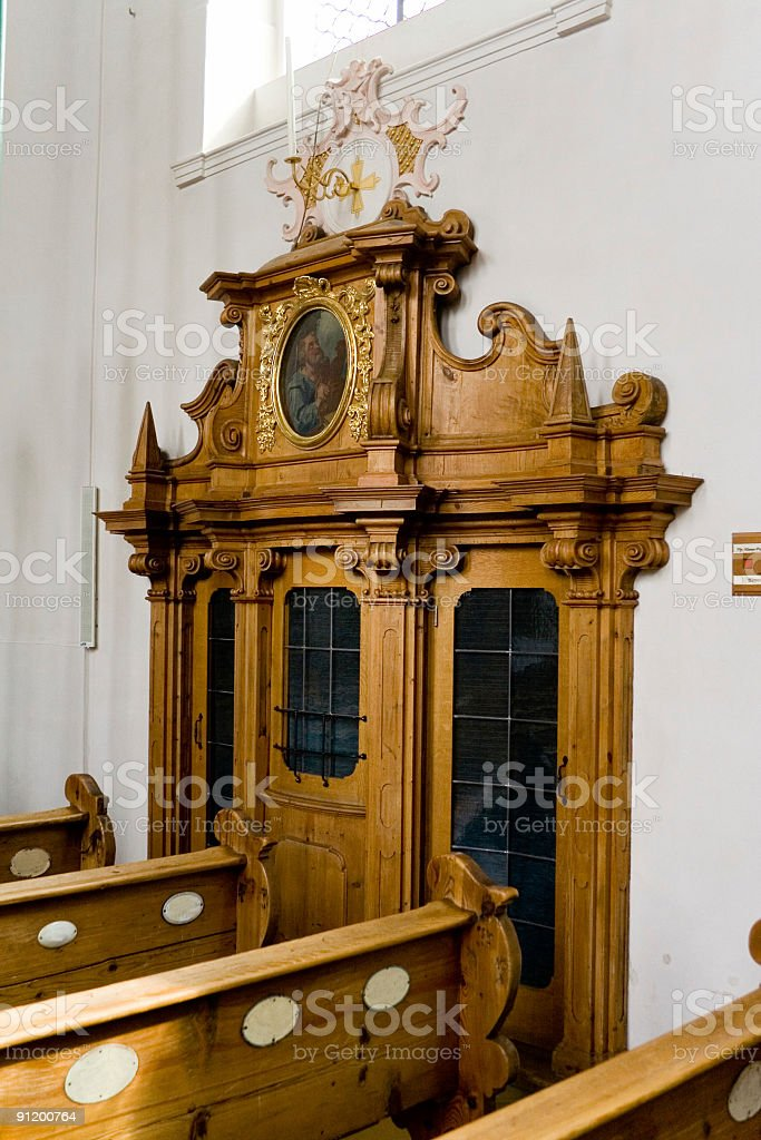 Confessional in a catholic Church royalty-free stock photo