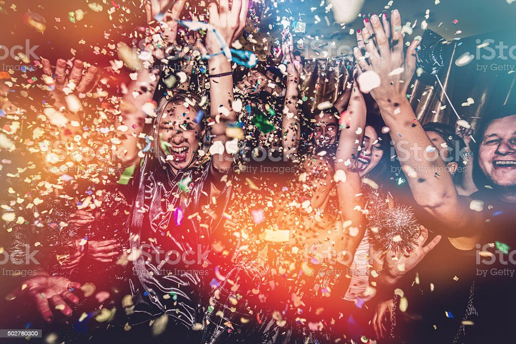 Confetti falling on a dance floor stock photo