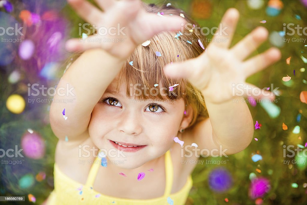 Confetti Falling On Little Girl stock photo