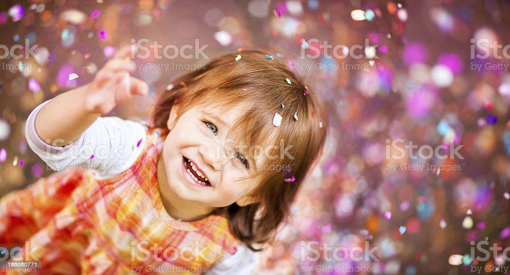 Confetti Falling On Little Girl stock photo