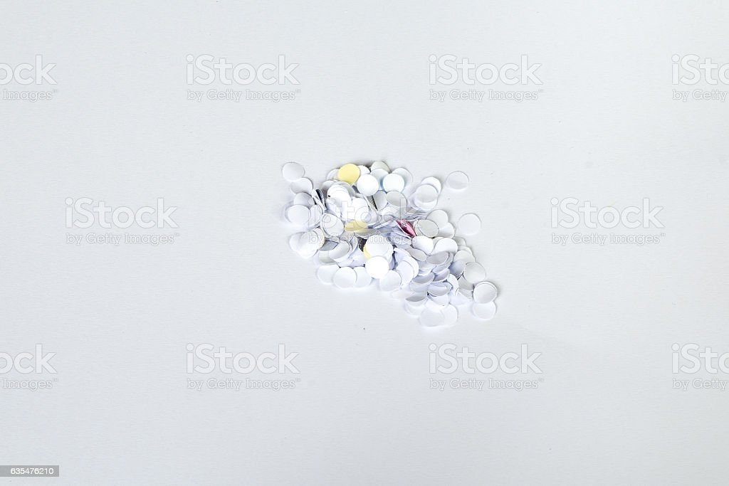 confetti from paper hold puncher stock photo