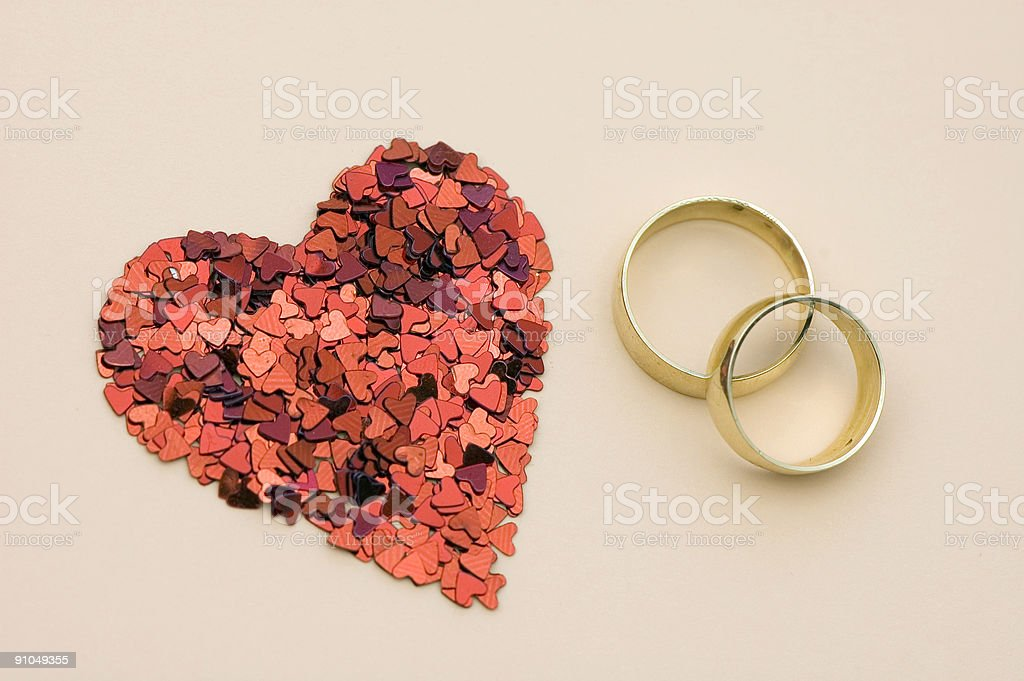 Confetti Heart and Wedding Rings royalty-free stock photo