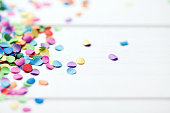 confetti on a white wooden background