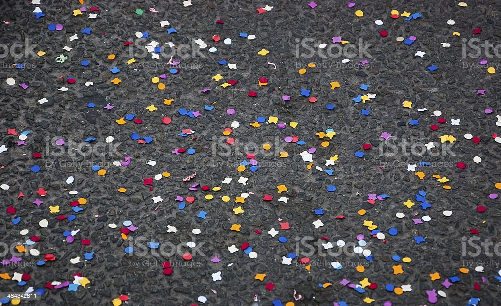 Confetti on pavement (after carnival procession passed). Party is over. stock photo