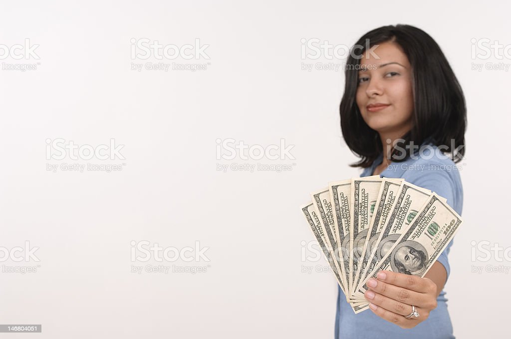 confidant hispanic woman holding 100 dollar bills royalty-free stock photo