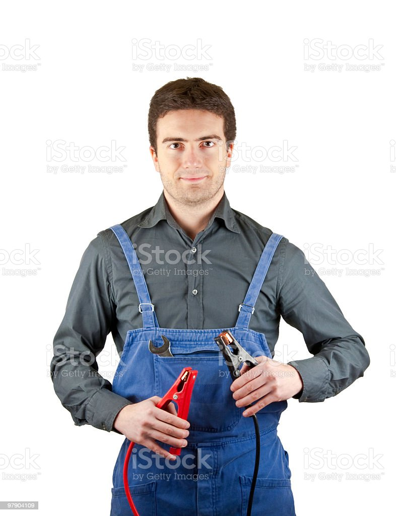 Confidence mechanic with battery cable stock photo