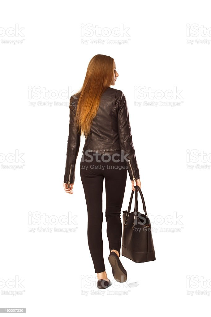 Confidence young woman back portrait in black on shopping. stock photo