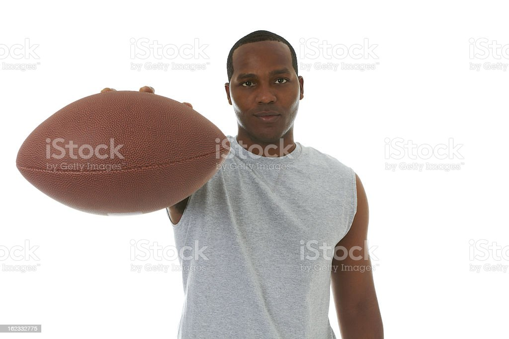 Confident african american male holding football stock photo