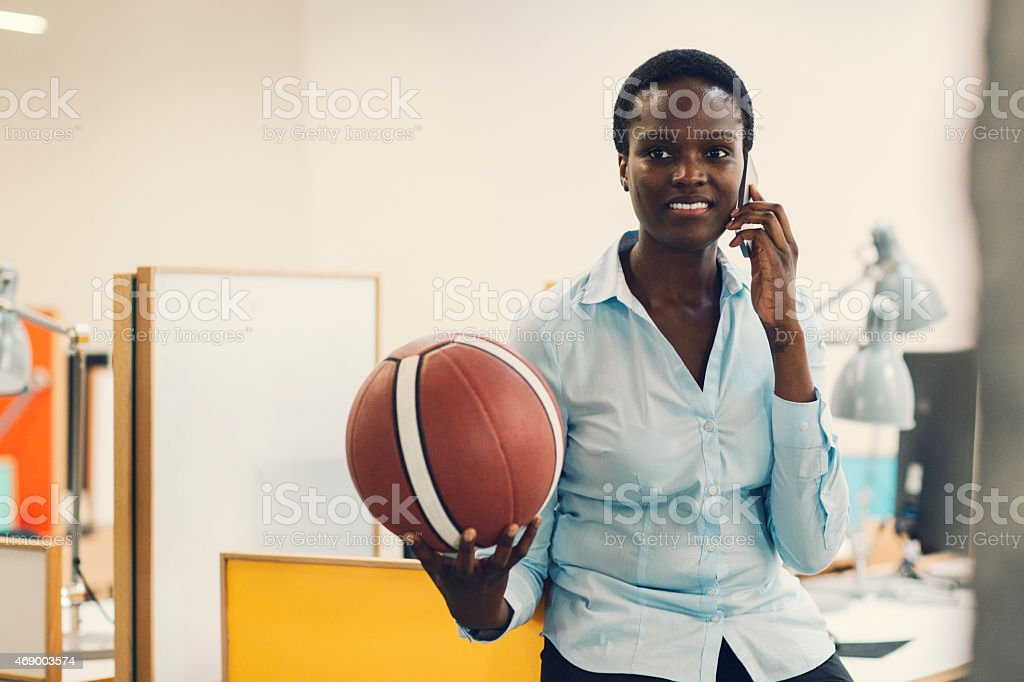 Confident African businesswoman Talking on the phone in office. stock photo