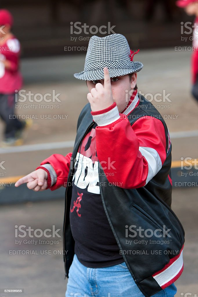 Confident Alabama Fan In Houndstooth Hat Makes Number One Gesture stock photo
