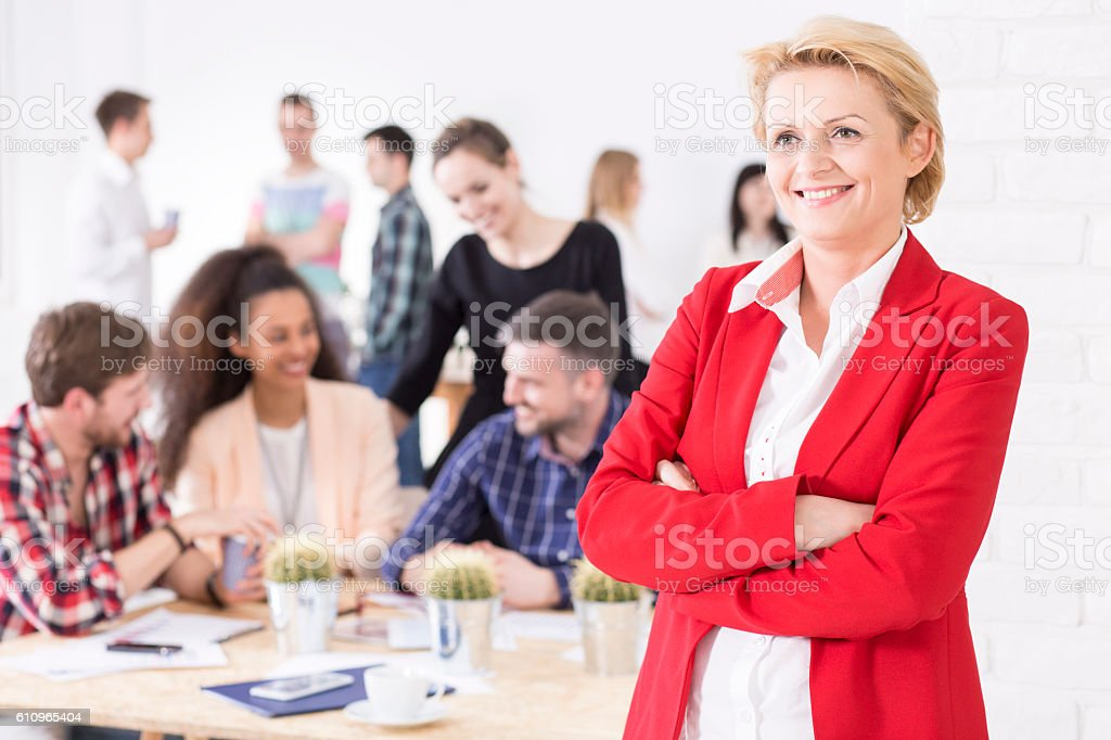 Confident and fulfilled middle-aged woman stock photo