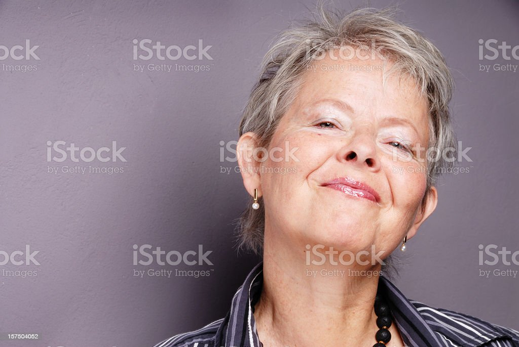 confident and happy senior woman royalty-free stock photo