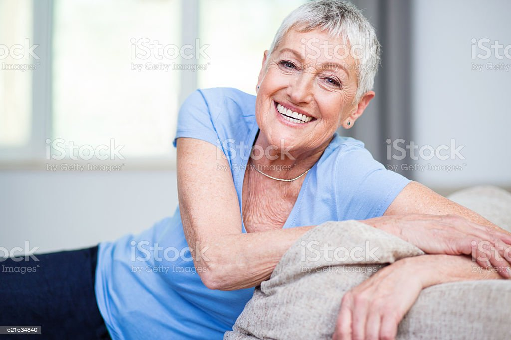 Confident and happy senior woman stock photo